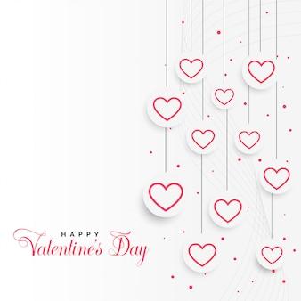 Fondo di giorno di biglietti di s. valentino con i cuori d'attaccatura
