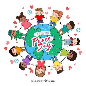 Fondo di giorno di pace con i bambini che si tengono per mano intorno a terra