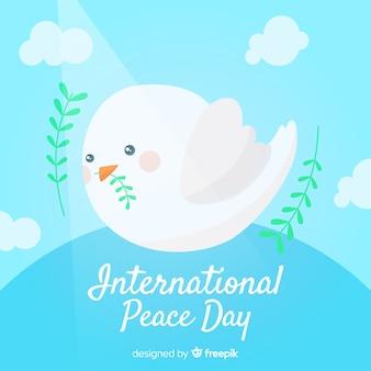 Fondo di giorno di pace con la colomba bianca