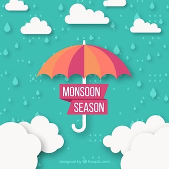 Fondo di stagione dei monsoni con le nuvole e l'ombrello