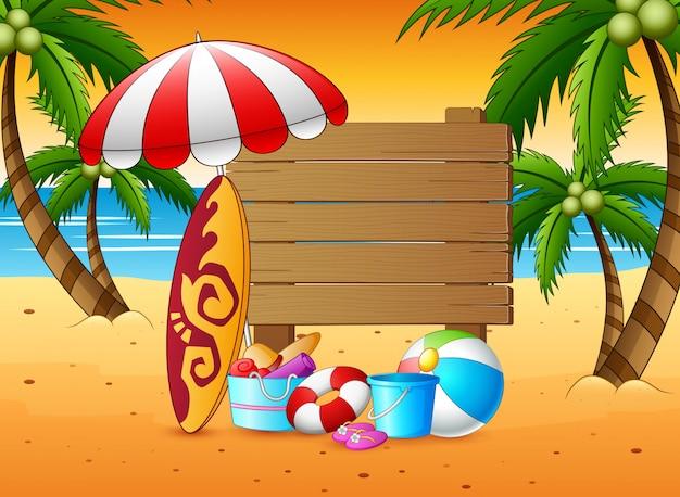 Fondo di vacanza estiva con un segno di legno e gli elementi della spiaggia