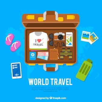 Fondo di viaggio con la valigia aperta