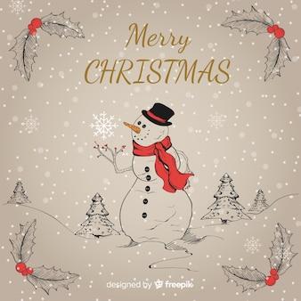 Fondo disegnato a mano del pupazzo di neve di natale