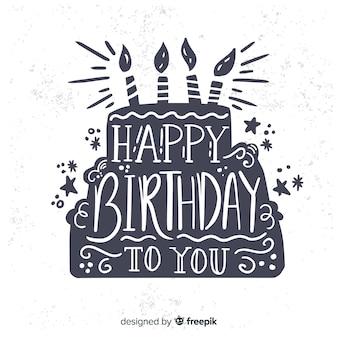 Fondo disegnato a mano dell'iscrizione di buon compleanno