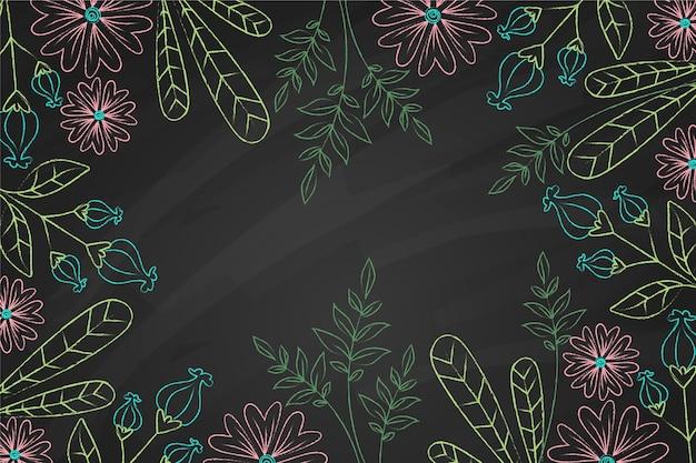 Fondo disegnato a mano di foglie e fiori di doodle