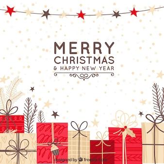 Fondo disegnato a mano di natale con i contenitori di regalo rossi e beige