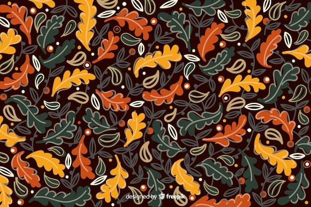 Fondo disegnato a mano variopinto delle foglie