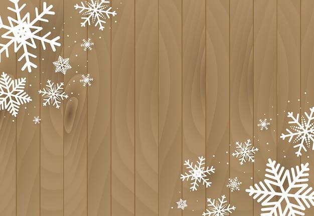 Fondo in legno con fiocchi di neve