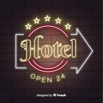 Fondo realistico dell'insegna al neon dell'hotel