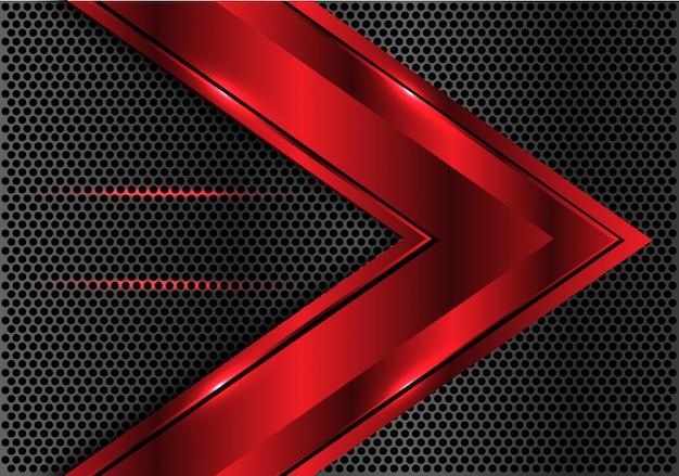Fondo scuro della maglia del cerchio di direzione metallica rossa della freccia.