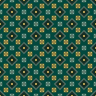 Fondo senza cuciture classico batik. carta da parati geometrica di lusso mandala. elegante motivo floreale tradizionale in colore verde