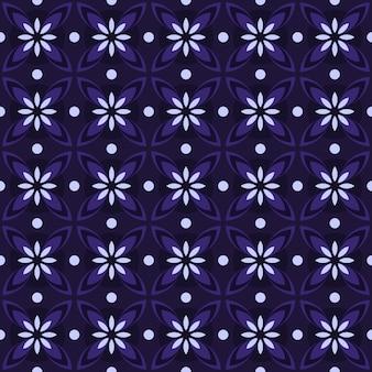 Fondo senza cuciture classico batik. carta da parati geometrica di lusso mandala. elegante motivo floreale tradizionale in colore viola