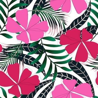 Fondo senza cuciture di tendenza estiva con foglie e fiori tropicali brillanti