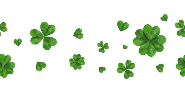 Fondo senza cuciture orizzontale del giorno di happy st. patrick con l'acetosella, trifoglio di quattro foglie isolato su fondo bianco. modello di simbolo dell'irlanda.