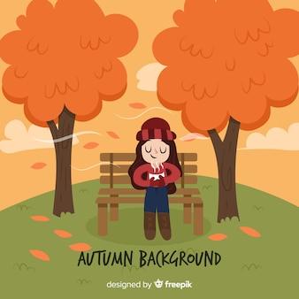 Fondo sveglio di autunno con il tè bevente della ragazza