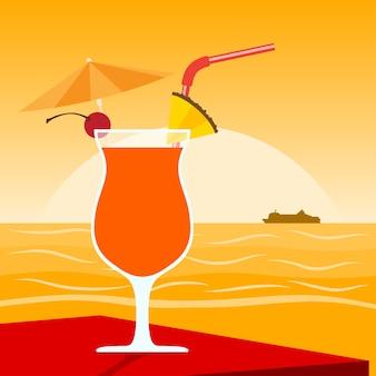 Foto di un cocktail in piedi sul tavolo davanti al tramonto sulla spiaggia