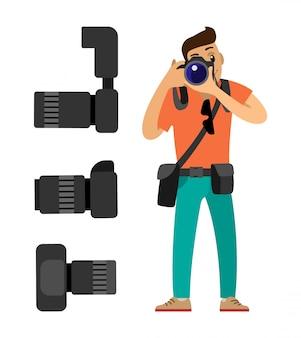 Fotografo con le macchine fotografiche digitali messe prendendo foto