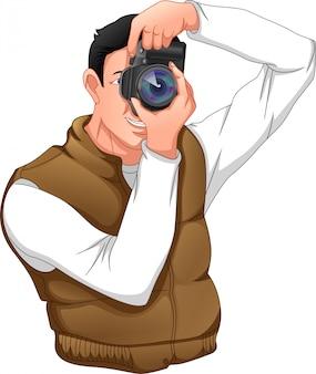 Fotografo in posa con la sua macchina fotografica