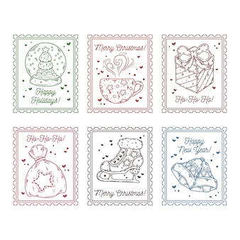 Francobolli allegri di natale con simboli di festa in mano disegnati