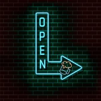 Freccia blu al neon con la scritta aperta e un bicchiere di birra su un muro di mattoni.