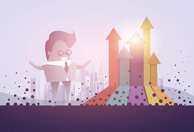 Freccia del grafico di finanza dell'uomo di affari sul concetto finanziario di successo