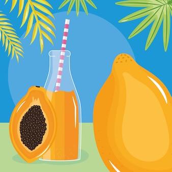 Frutta fresca del succo di papaia in botttle con paglia in foglie di palme