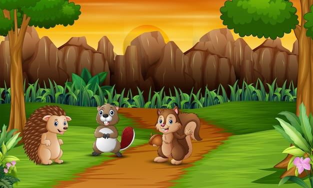 Fumetto degli animali felici sulla scena della natura