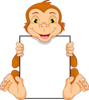 Fumetto sveglio della scimmia e segno in bianco