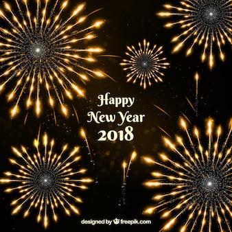 Fuochi d'artificio dorati del nuovo anno