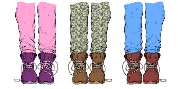 Gambe in pantaloni e stivali.