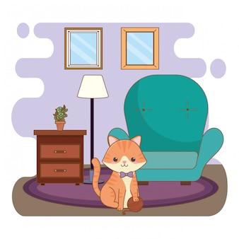Gatto che gioca con il gomitolo di lana nel soggiorno