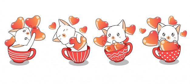 Gatto e cuori adorabili dentro una tazza nel giorno di biglietti di s. valentino