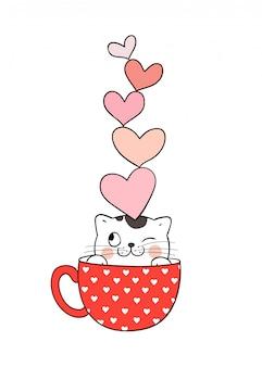 Gatto in tazza di tè e cuori sulla testa