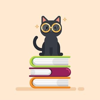 Gatto sveglio che si siede su una pila di libri
