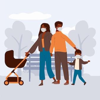 Genitori che camminano con i loro bambini con maschere mediche all'aperto