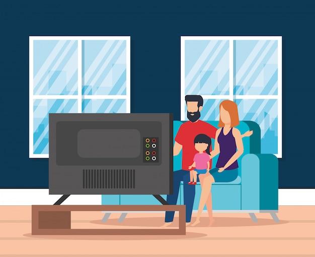 Genitori con la figlia che guardano la televisione