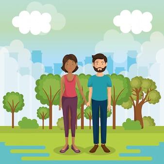 Genitori coppia fuori nel paesaggio