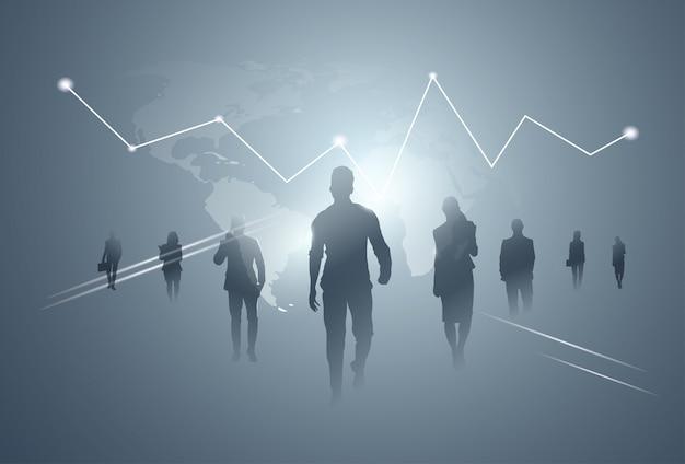 Gente di affari del gruppo della siluetta della squadra sopra fondo del grafico di finanza