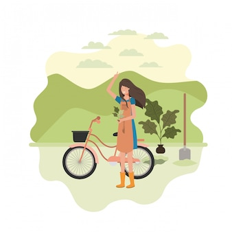 Giardiniere della donna con paesaggio e bicicletta