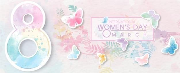 Gigante del numero 8 con volo di farfalle colorate e formulazione dell'evento del giorno delle donne sul modello di carta bianca e pianta sfondo colorato.