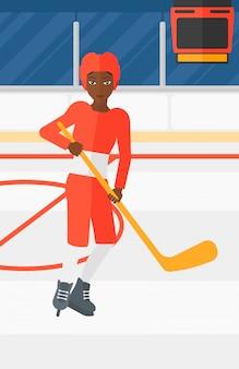 Giocatore di hockey su ghiaccio con bastone
