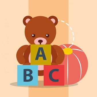 Giocattoli orso teddy palla di plastica e blocchi alfabeto