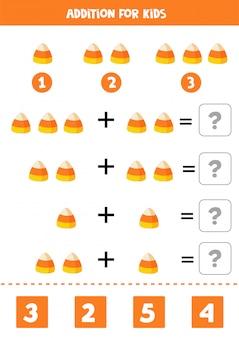 Gioco di matematica aggiunta con caramelle di halloween simpatico cartone animato.