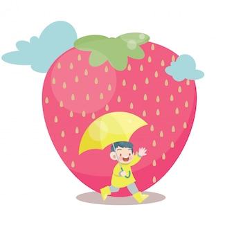 Gioco felice del bambino nella pioggia della frutta della fragola