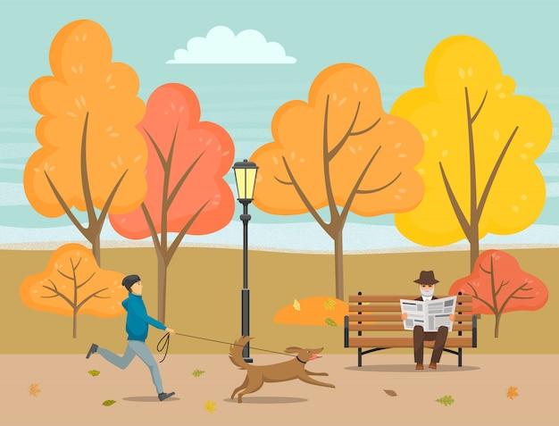 Giornale della lettura dell'uomo senior in autumn park