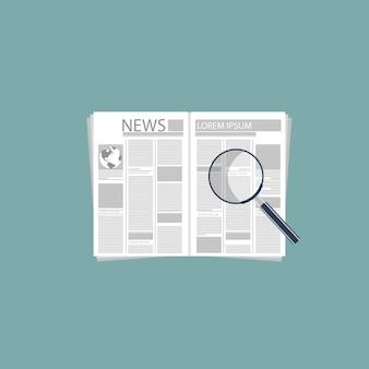 Giornale e lente d'ingrandimento