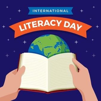 Giornata internazionale dell'alfabetizzazione con libro aperto e pianeta