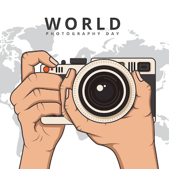 Giornata mondiale della fotografia con le mani tenendo la fotocamera
