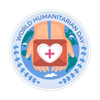 Giornata mondiale umanitaria con le mani in possesso di kit di aiuto