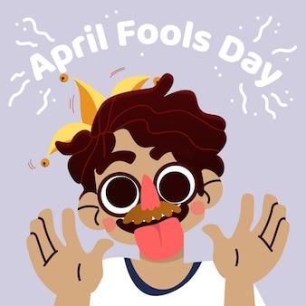 Giorno dei pesci d'aprile con la persona che indossa la maschera